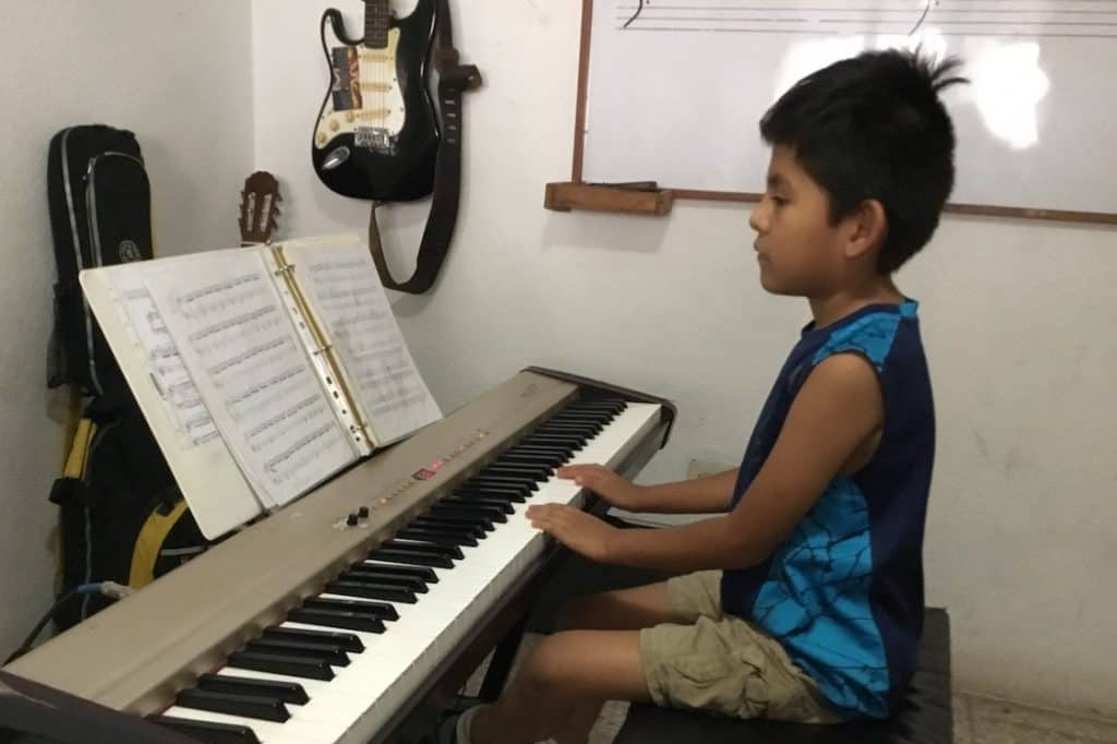 A student learns to play keyboard at the Atitlan Music School